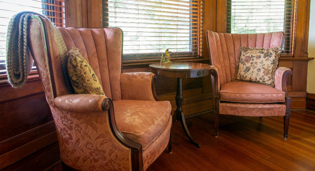 Two Wingback chairs in front of bay window