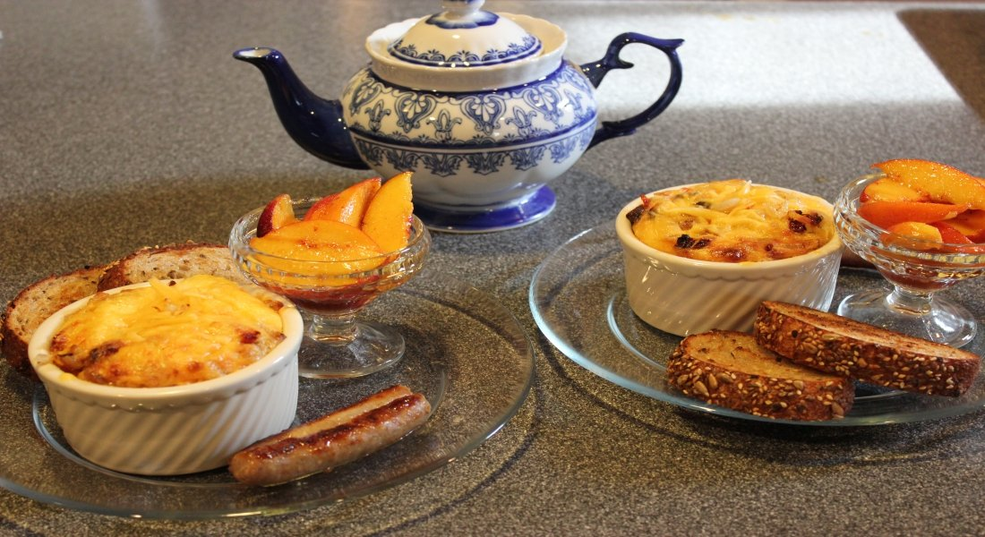 Egg souffle casseroles with teapot