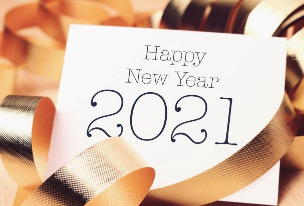 The words Happy New Year 2021 on postcard surrounded by gold ribbon