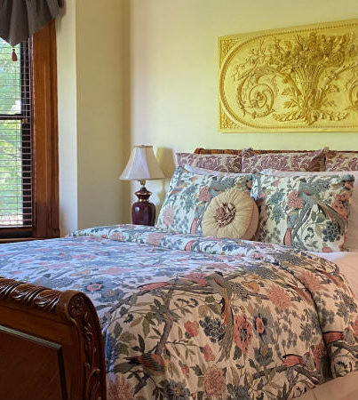 Sleigh bed with floral comforter