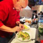 Chef Mark Drake in red chef coat preparing breakfast plate