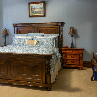 Mahogany bed with blue comforter