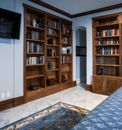 Book cases, wall television, California king bed, bookcases