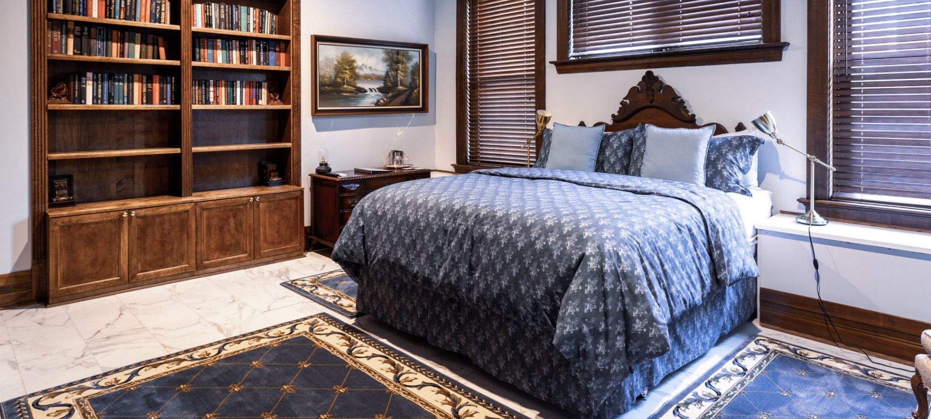 California King bed with fleur de lys comforter, work station, book cases