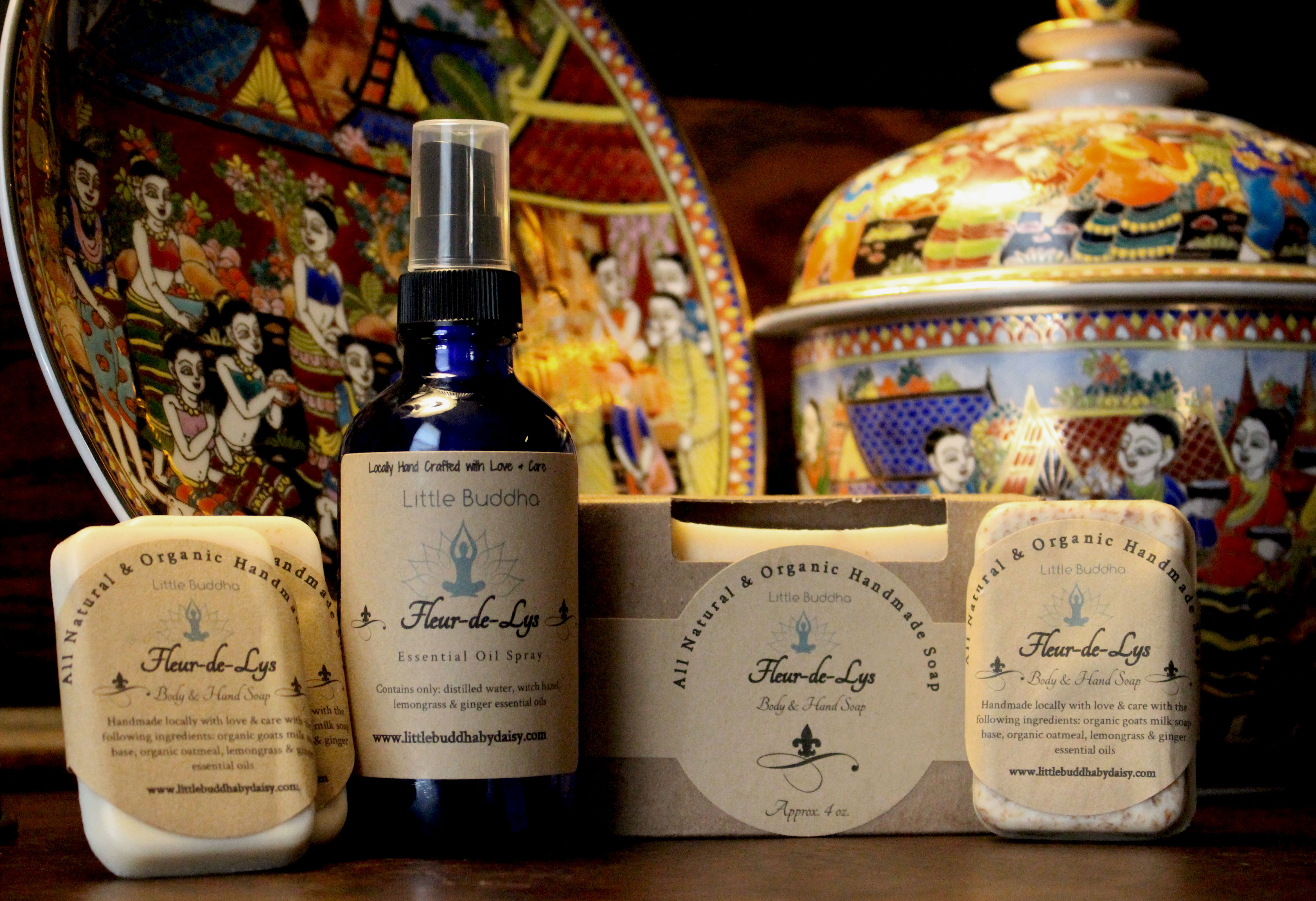 Hand crafted soaps displayed next to Thai pottery.