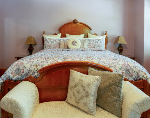 King bed with floral comforter, large matching pillows