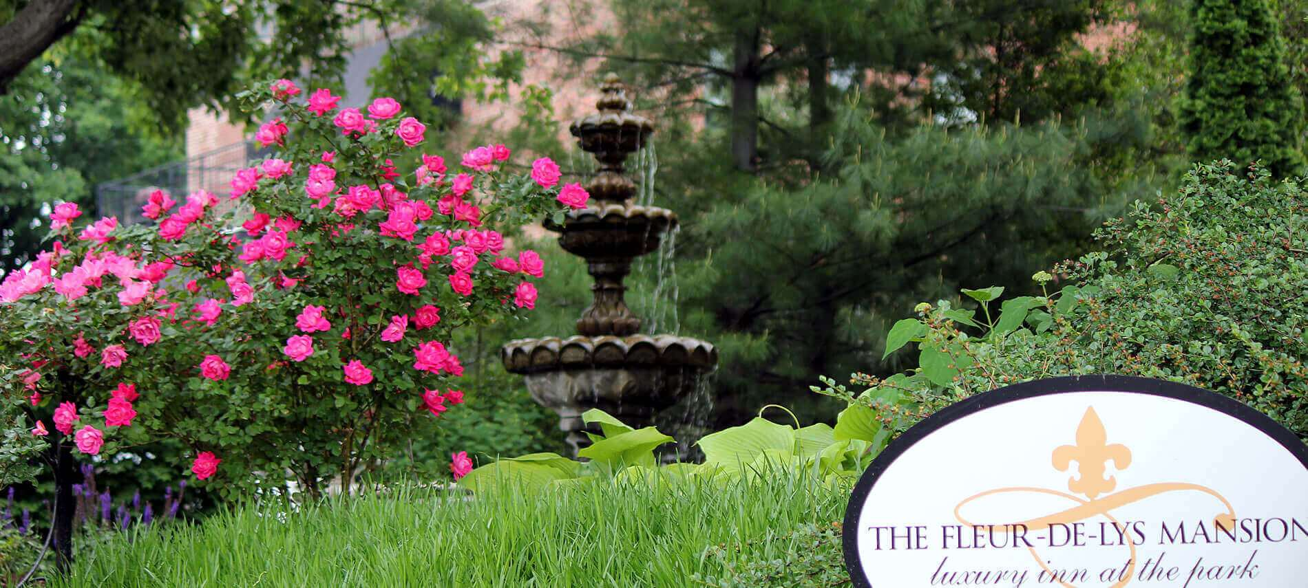 3 tier fountain with pink flowers